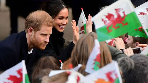 Prince Harry and Meghan Markle were greeted by hundreds of well-wishers in Wales and despite arriving an hour late into Cardiff, the crowd were still enthusiastic. (Getty)