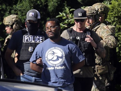 Salt Lake City police take Ayoola A. Ajayi into custody in connection with missing University of Utah student MacKenzie Lueck i (Kristin Murphy/The Deseret News via AP)