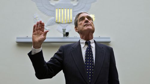In this June 13, 2013 file photo, FBI Director Robert Mueller is sworn in on Capitol Hill in Washington prior to testifying before the House Judiciary Committee as it holds an oversight hearing on the FBI.