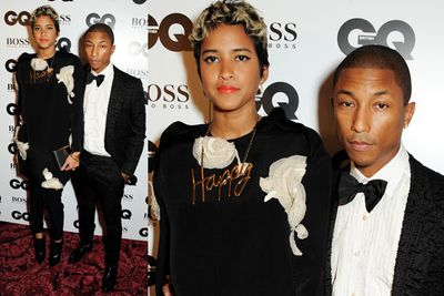 Pharrell Williams with a guest. WTF is that dress?
