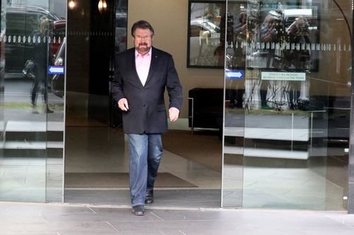 Mr Hinch walks out to front the media. (AAP)