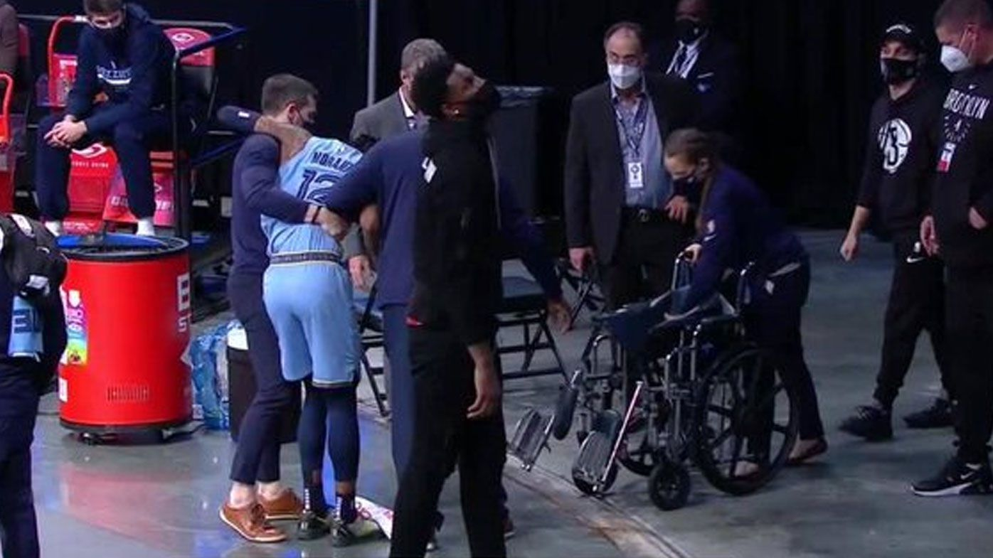 Reigning NBA Rookie of the Year Ja Morant chaired off court after serious ankle injury
