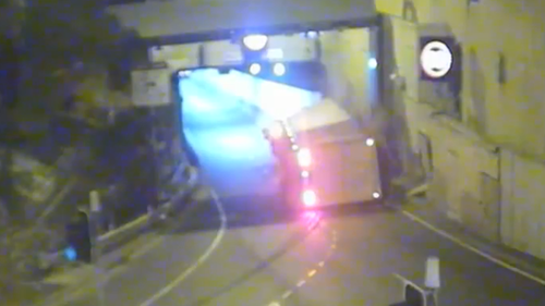 The truck damaged a wall at the tunnel entrance as it overturned.