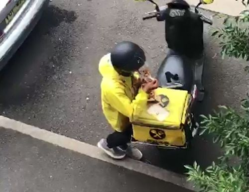 A delivery driver has been caught eating from the order he was delivering.
