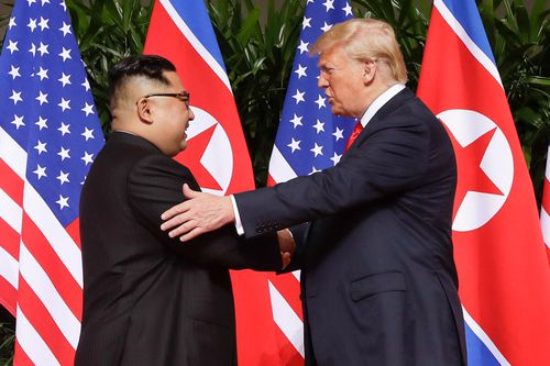 Trump shakes hands with North Korea leader Kim Jong Un at the Capella resort on Sentosa Island, in Singapore.