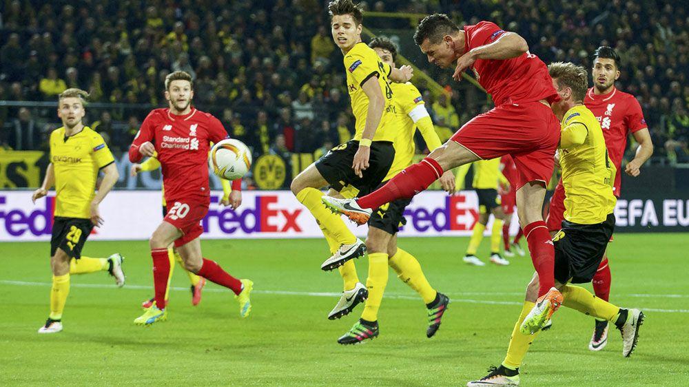 Reds grab draw in Klopp's Dortmund return