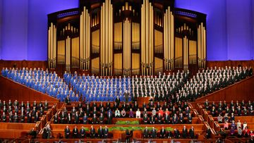 The Mormon Tabernacle Choir and church leaders sing together in the Conference Center during the 186th Annual General Conference of the Church of Jesus Christ of Latter-Day Saints.