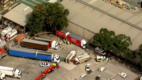 A person has been injured by a truck at a service station in Yagoona.