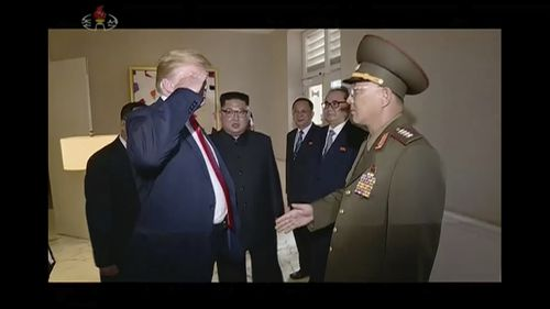 President Donald Trump salutes No Kwang Chol, minister of the People's Armed Forces of North Korea