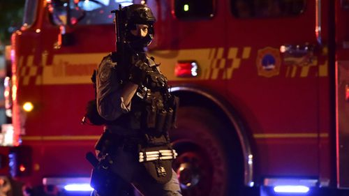 Heavily armed police at the scene. Picture: AP