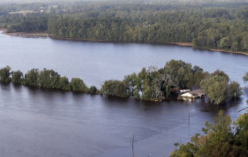 A home is surrounded by floodwaters in Marion, South Carolina.
