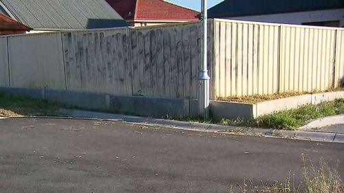 Mr Phillip's body was found against this fence, which is the backyard of a family home.