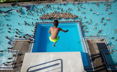 Pools and beaches are packed across parts of Europe.