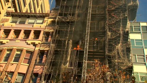 The blaze has stripped bare the exterior of the under construction building. Picture: 9NEWS