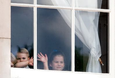 The Cambridge children waving from a window of Buckingham Palace ahead of Trooping The Colour.