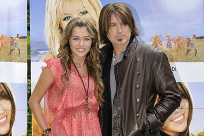 Although most celeb offspring struggle to reach the heights of their parents' fame, some exceed them. Miley Cyrus was far more successful by the age of 15 than singer Billy Ray was in his whole career, but at least she created the opportunity for him to take to the spotlight again in his role as Celebrity Dad. He's often moaned to the press about the affect of Miley's <i>Hannah Montana</i> fame on his family, and expressed concern about her hard-partying ways. Perhaps things will settle down now she's engaged to Aussie hunk Liam Hemsworth &#151; Billy Ray gave his approval when the news was announced, but said he hoped they'd have a 'long engagement'.