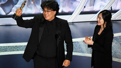 Bong Joon-ho accepts the International Feature Film award for 'Parasite'.