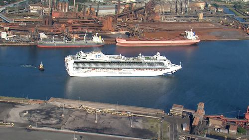 The Ruby Princess cruise ship, carrying more than 1000 crew, docks at Port Kembla with an unknown number infected with coronavirus.