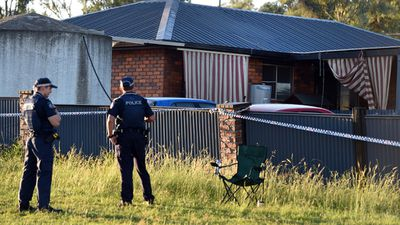 Forensic investigators are at the scene where the bodies of a man, woman and young boy have been found. (AAP)