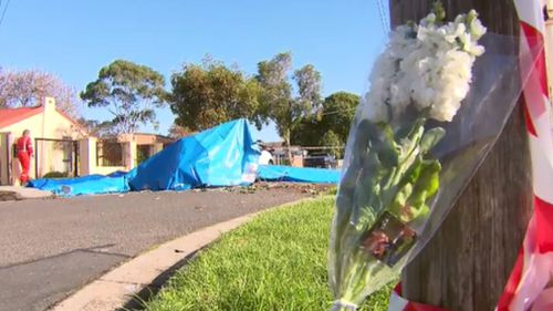 Flowers laid at the scene of the crash. (9NEWS)