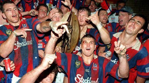 Newcastle Knights players revel after their victory in the 1997 grand final.