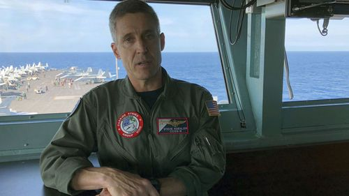 Rear Admiral Steve Koehler, commander CSG-9 of the U.S. aircraft carrier Theodore Roosevelt, briefs top Philippine generals in international waters off South China Sea.