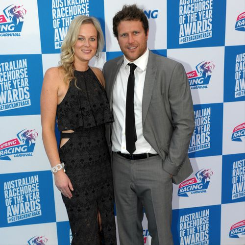 Campbell Brown and his wife Jess pose for photos at the launch of the Spring Racing Carnival at the Melbourne Museum in Melbourne in 2014.
