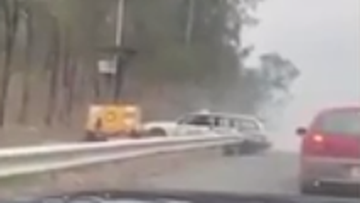 Video posted to Facebook shows a white station wagon ramming a roadside speed camera near Ipswich.