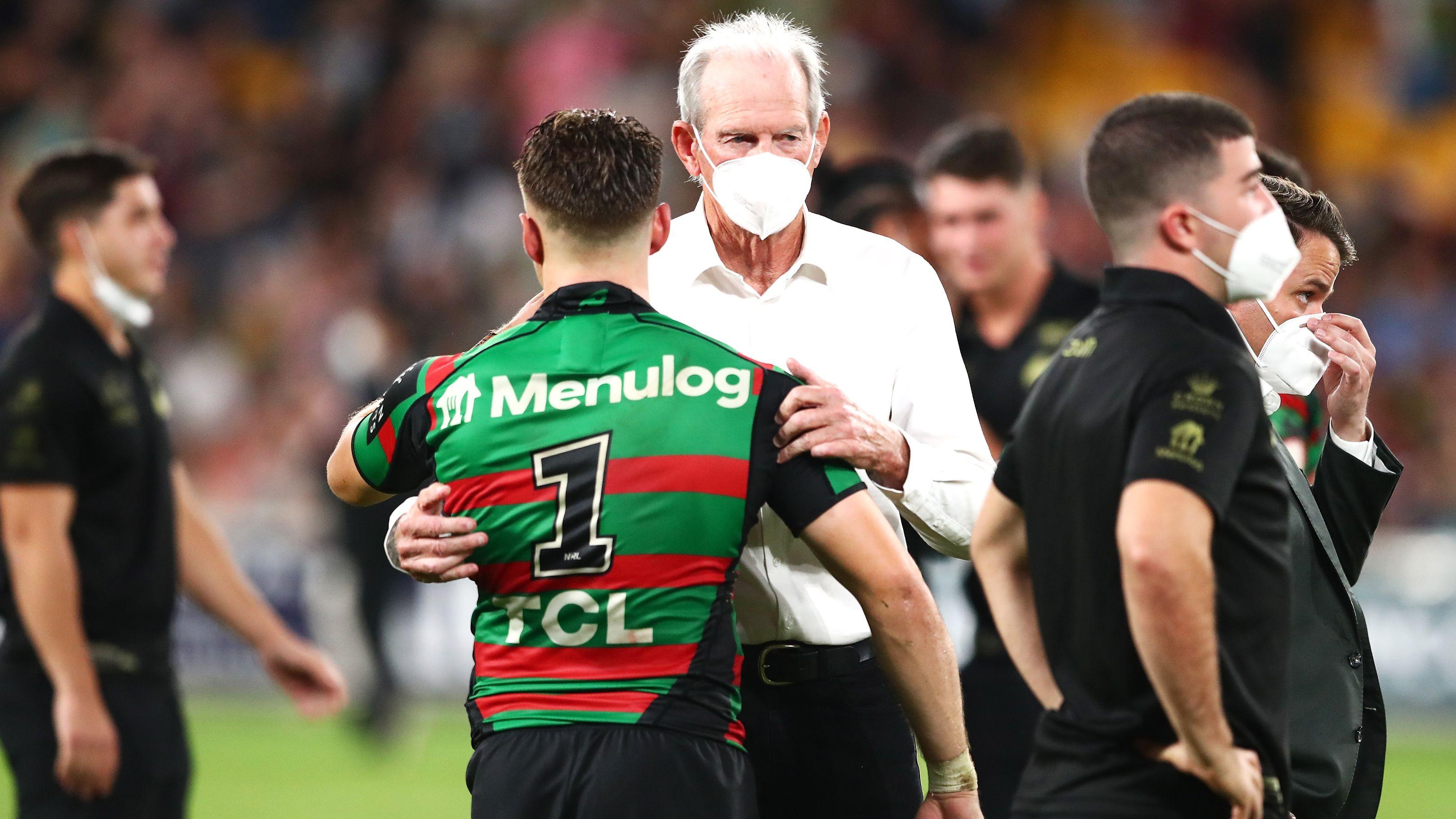 South Sydney coach Wayne Bennett embraces Blake Taaffe.