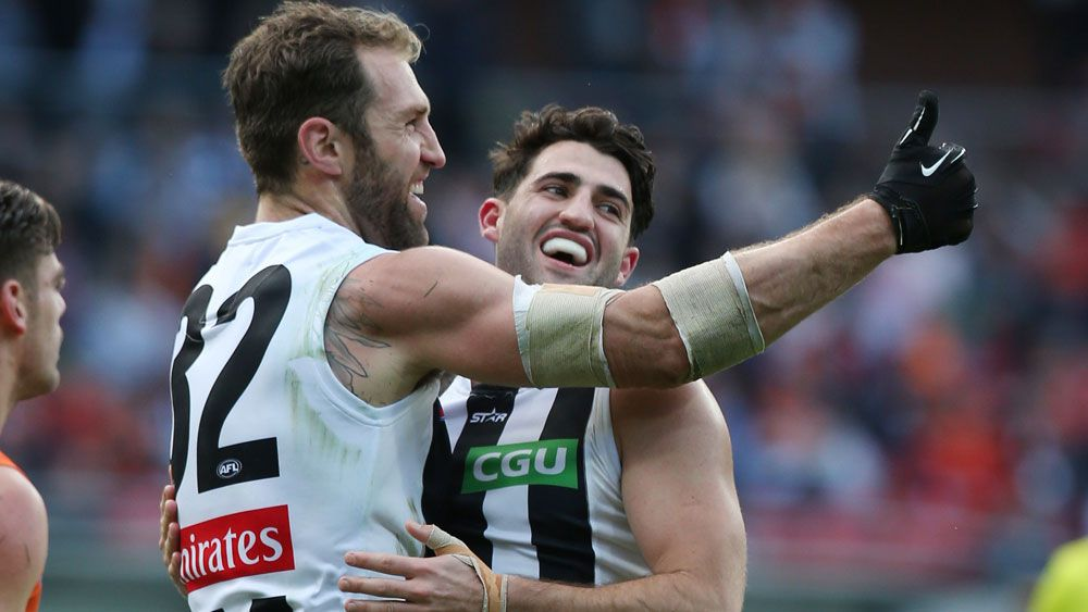 Travis Cloke took 12 marks with the help of the glove. (AAP)
