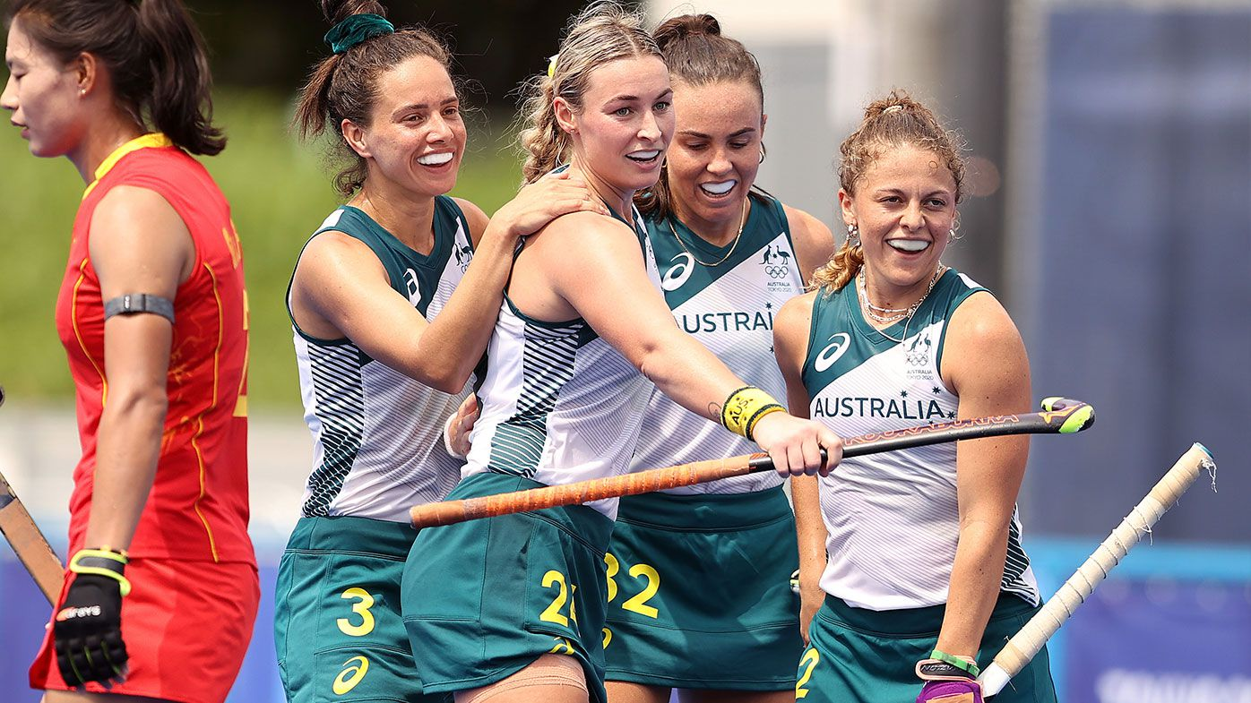 Ambrosia Malone #2 of Team Australia is congratulated by her teammates after scoring a goal against Team China during the Women's Preliminary Pool B match on day three of the Tokyo 2020 Olympic Games at Oi Hockey Stadium on July 26, 2021 in Tokyo, Japan. (Photo by Francois Nel/Getty Images)