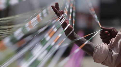 A file photo of kite strings in the national colours of India. Some strings are being laced with glass shards. (AAP)