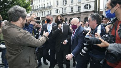 Actor Johnny Depp, centre, arrives at the High Court to give evidence in his libel case, in London, Wednesday July 15, 2020.