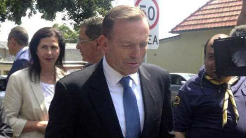 Prime Minister Tony Abbott fields questions outside St Marks Coptic Orthodox Church in Sydney yesterday. (AAP)