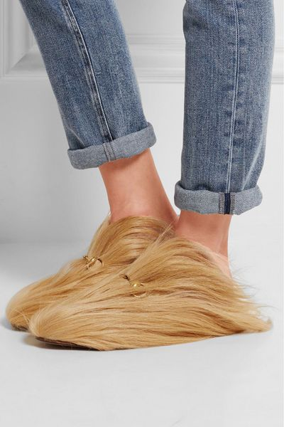 """<p>Well it is getting chilly. Time to swap your trusty Uggs perhaps?</p> <p><a href=""""https://www.net-a-porter.com/au/en/product/607338/Gucci/horsebit-detailed-goat-hair-slippers"""" target=""""_blank"""" draggable=""""false"""">Gucci Horsebit-detailed goat hair slippers</a>, $2,065</p>"""