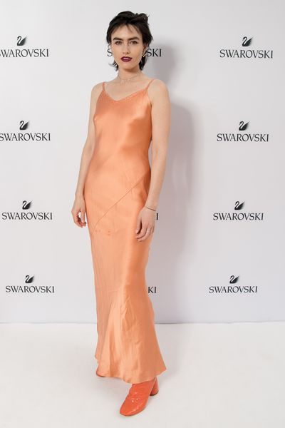 Isabella Manfredi in a dress from Reuze vintage and Ellery boots at the Swarovski Rainbow Collection launch in Sydney.