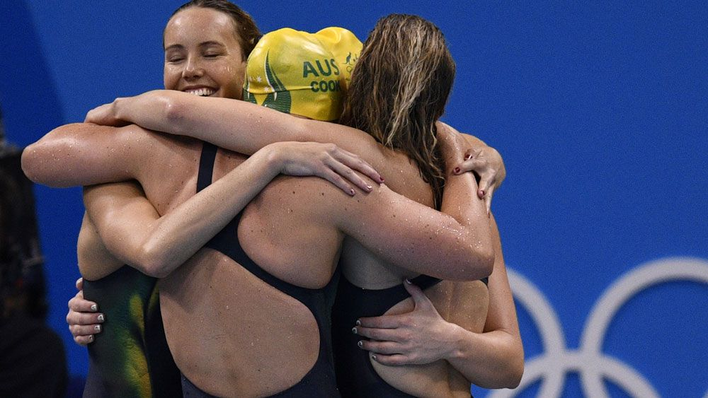 The women's relay team celebrate winning silver. (AFP)