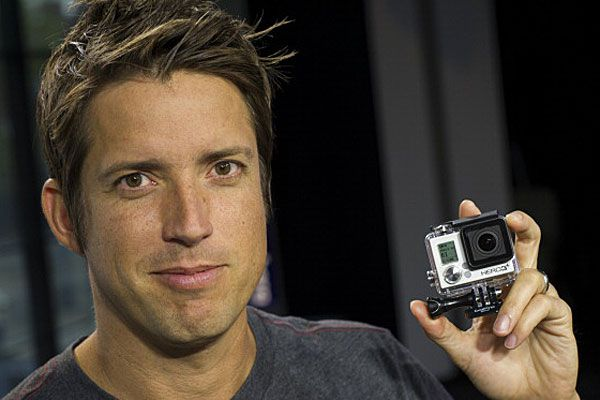 GoPro CEO holding GoPro camera