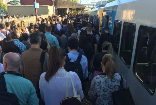 Passengers queue for a train in Clifton Hill (Twitter / @Aprilgobravo)