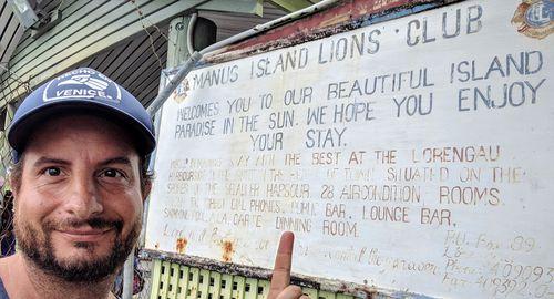 Dan Ilic at the Manus Island welcome sign.