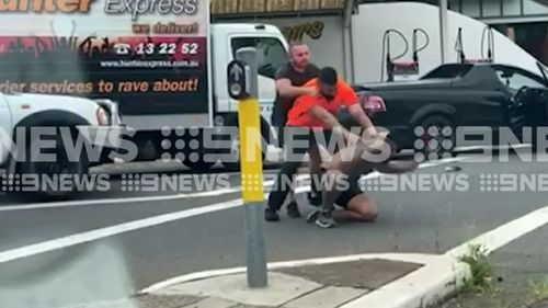 The two men fought at the intersection of Homer Street and Bayview Road in Earlwood earlier this week.