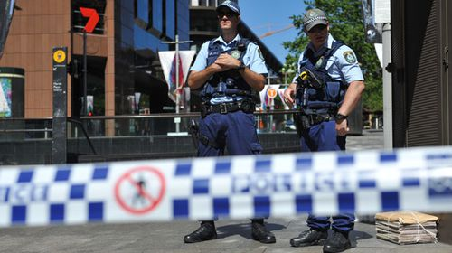 NSW Police are seen in Martin Place near the Lindt Cafe in the Sydney CBD. (AAP)