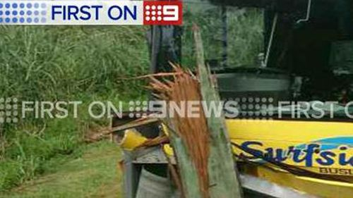 Driver and two kids taken to Tweed hospital after school bus crashes into power pole