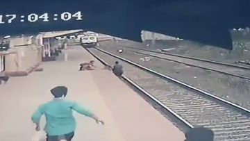 See the moment a child is saved from an oncoming train