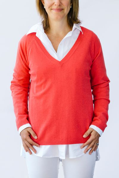 "<a href=""https://www.bowandarrowshop.com.au/collections/women/products/red-v-neck-jumper"" target=""_blank"" draggable=""false"">Bow &amp; Arrow Red V Neck Sweater, $149.</a>&nbsp;Slip a crimson knit over your blouse just like Victoria Beckham  - but with a little more room around the tummy. Well, only if you need it."