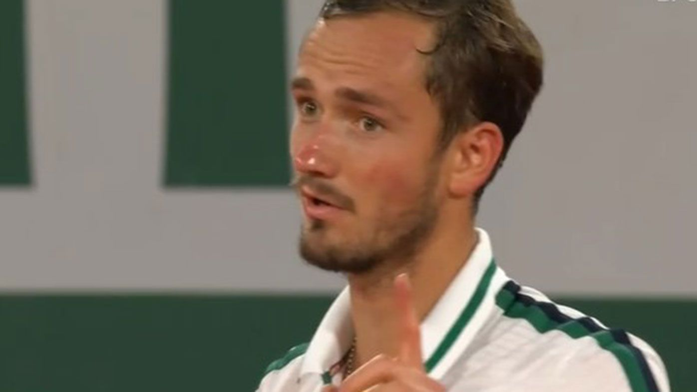 Daniil Medvedev argues with the umpire during his Roland-Garros loss to Stefanos Tsitsipas.