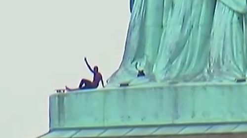 The protester climbed the base of the Statue of Liberty during Independence Day celebrations. Picture: Supplied