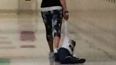 Teacher loses job after dragging small child along the hall by his arm.