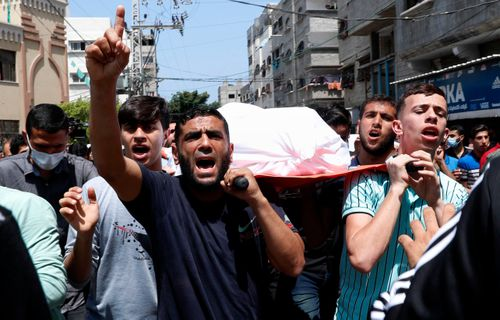 Mourners carry the body of Amira Soboh, and her 19-year-old disabled son Abdelrahman, who were killed in Israeli airstrikes