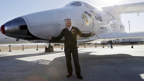 """""""Space feels tantalisingly close now,"""" founder Richard Branson tweeted. He is pictured with SpaceShipTwo in Mojave in September 2013. (AAP)"""